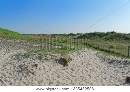 Panoramic View At Grass Covered Sand Area In Sankt Peter-ording, Northern Germany