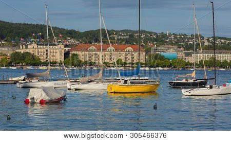 Zurich, Switzerland - June 8, 2019: Boats On Lake Zurich At Sunset, Buildings Of The City Of Zurich