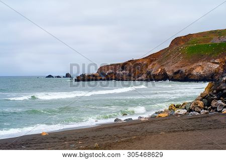 Waves Rolling In On A Sandy Beach, Surrounded By Coastal Hiking Trails At Rockaway Beach, Pacifica,