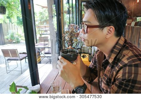Unaware Man Or A Man Is Drinking Coffee
