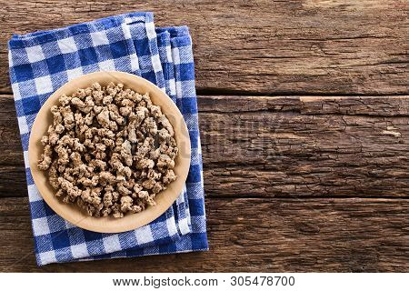 Raw Dehydrated Soy Meat, Soy Protein, Soya Chunks Or Textured Vegetable Protein On Wooden Plate, Pho