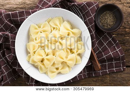 Fresh Cooked Farfalle, Bow-tie Or Butterfly Pasta Served In Bowl Without Sauce, Ground Black Pepper
