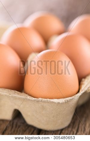 Raw Brown Eggs In Egg Box Or Carton (very Shallow Depth Of Field, Focus On The Front Of The First Eg