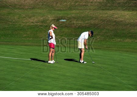 Marbella, Spain - November 12, 2008 - Two Women Playing Golf On The Putting Green At The Rio Real Go
