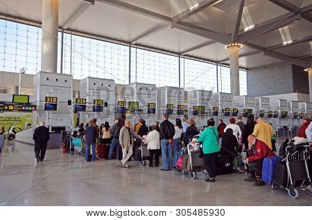 Malaga, Spain - March 16 2010 - Passengers Waiting To Check In For Flights In Terminal Three Departu