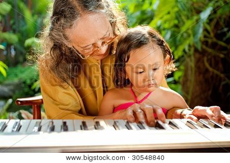 Asian Senior Woman Teach Child Playing Piano