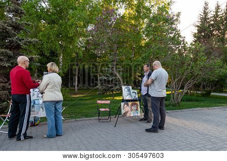 Novosibirsk, Russia - 05.28.2019: Artists With Pictures Of People At Easels In The City Park Offer T