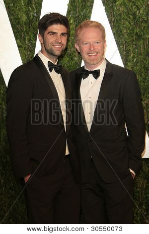 LOS ANGELES - FEB 26:  Justin Mikita; Jesse Tyler Ferguson arrive at the 2012 Vanity Fair Oscar Party  at the Sunset Tower on February 26, 2012 in West Hollywood, CA