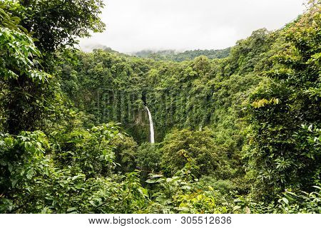 Waterfall In The Arenal National Park, Near Volcano Of Arenal