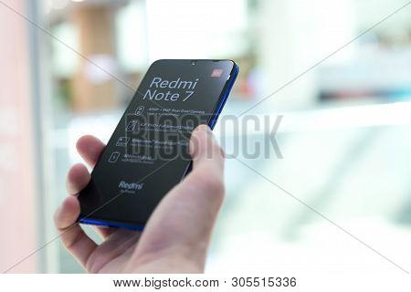 Belgrade, Serbia - Jun 06, 2019: New Xiaomi Redmi Note 7 Mobile Smartphone Is Displayed In Hand On I