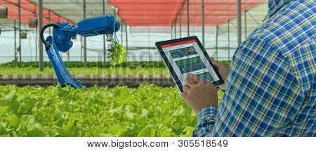 Iot Smart Industry Robot 4.0 Agriculture Concept,industrial Agronomist,farmer Using Software Artific
