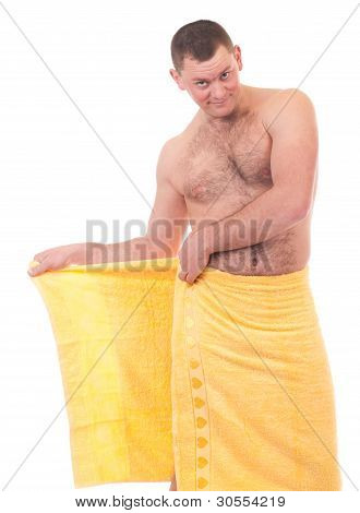 Beautiful athletic man in yellow towel