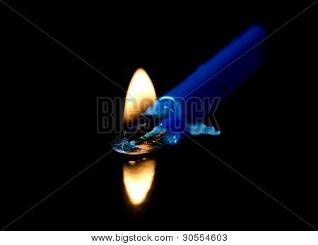 Burning Blue Candle On A Black Background