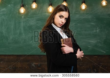 Portrait Of Girl Teenager In School. Young Teenager With School Books. Back To School. Beautiful Fem