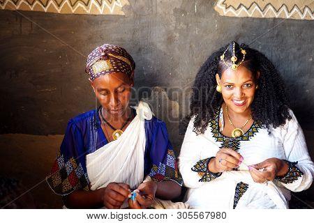 Alitena, Ethiopia - 2 June 2019 : Two Women Work On Beading A Traditional Ethiopian Wedding Decorati
