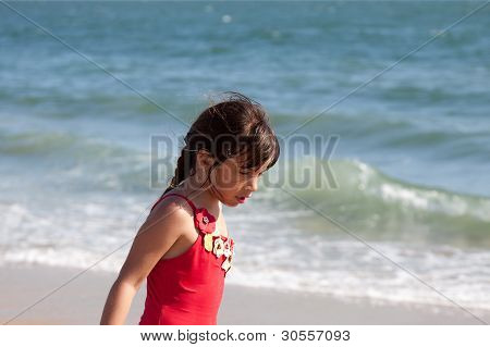 Little Girl Relaxing By The Ocean