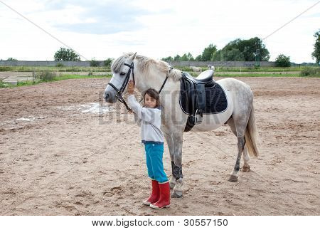 Little Girl Ready For A Horseback Riding Lesson