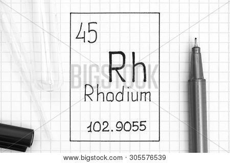 The Periodic Table Of Elements. Handwriting Chemical Element Rhodium Rh With Black Pen, Test Tube An