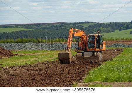 Excavator At A Construction Site. Building. Excavator. Close Up. Excavation Work At A Construction S