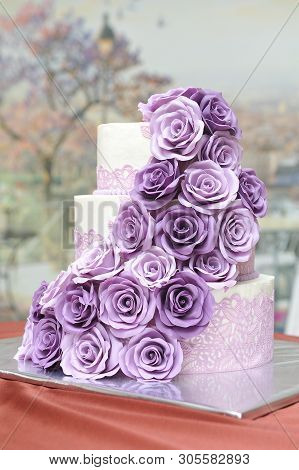 A Beautiful Three-tiered Wedding Cake Decorated With Mastic And Roses Molded Mastic Flowers Of Lilac