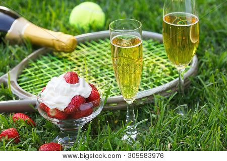 Strawberries With Whipped Cream, Glasses With Champagne And Tennis Equipment On Wimbledon Tournament