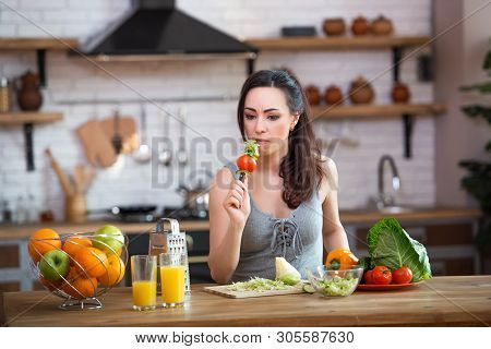 Jealousy And Suffering. Wife Angry At Her Husbands Treason. Woman With A Knife In His Hands Thinks O
