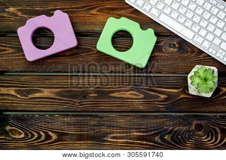 Office Desk Of Blogger With Camera, Keyboard And Plant On Wooden Background Top View Copy Space