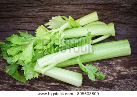Fresh Vegetable Of Celery Sticks And Leaf / Bunch Of Celery Stalk On Rustic Wood Background