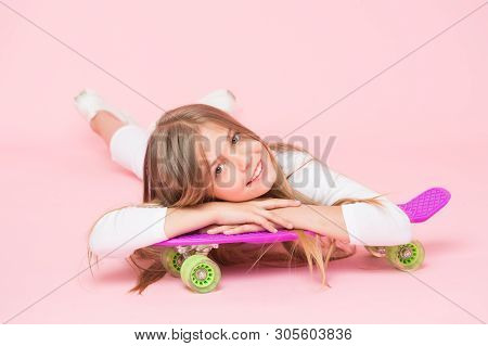 Spreading Happy Vibrations With The Penny Board. Small Girl Skater Relaxing At Penny Board Deck On P