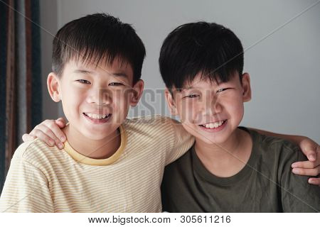 Happy Asian Tween Boys Smiling And Hugging Each Other, Preteen Boys Portrait, Friendships