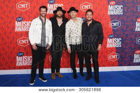 NASHVILLE - JUN 5: (L-R) Chris Thompson, James Young, Jon Jones and Mike Eli of the Eli Young Band attend the 2019 CMT Music Awards at the Bridgestone Arena on June 5, 2019 in Nashville, Tennessee.