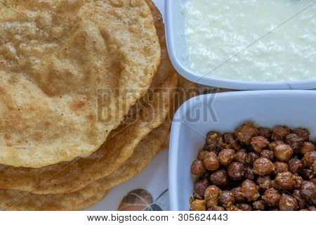 Kala Channa And Curd With Puri, Indian Dish Or Black Chickpeas With Fried Bread. Selective Focus.