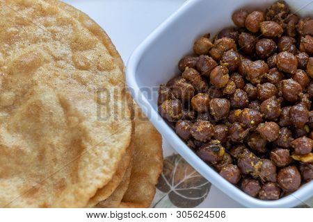 Kala Channa With Puri, Indian Dish Or Black Chickpeas With Fried Bread. Selective Focus.