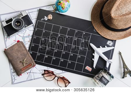 Vacation Calendar With Camera And Travel Items, Top View