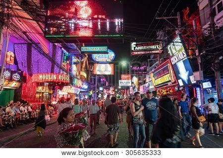 Pattaya, Thailand - March 06, 2019: Crowd Of People Enjoy Night Life At Walking Street In Pattaya, T