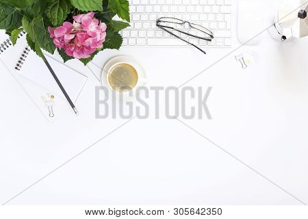 Office White Desk Top View Coffee, Keyboard, Mouse, Flower