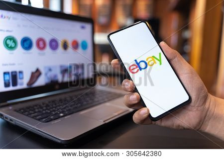 Chiang Mai, Thailand - May.01,2019: Man Holding Xiaomi Mi Mix 3 With Ebay Apps On The Screen. Ebay I