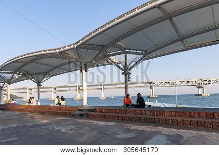 Busan, South Korea - April 2019: People Relaxing And Enjoying View Of Busan Gwangandaegyo Bridge Or