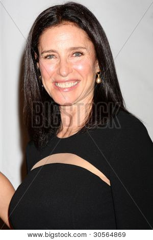 LOS ANGELES - FEB 26:  Mimi Rogers arrives at the