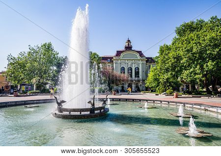 Plovdiv, Bulgaria - May 2, 2017. Water Fountain At Main Square In European Plovdiv