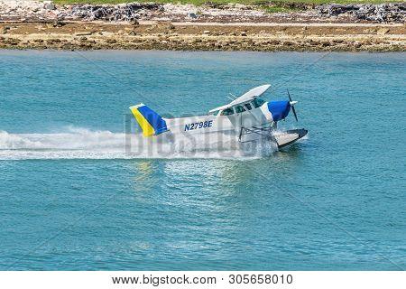 Miami, Fl, United States - April 20, 2019: The Seaplane Cessna 172n Skyhawk Takes Off In The Miami M