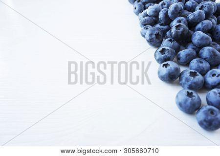 Sprinkled Blueberries On White Background. Ripe Blueberries With Copy Space For Text. Blueberry On A