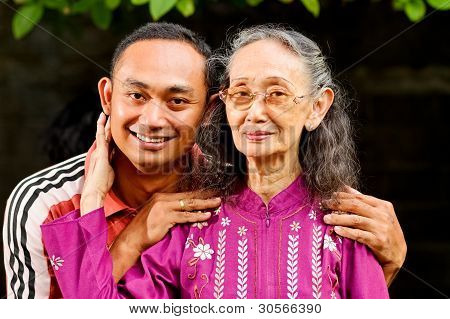 Happy Asian Young Man Embrace Elderly Mother