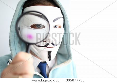 Minsk, Belarus, June, 2019: Hacker Wear Anonymus Mask With Magnifying Glass Illustrative Editorial