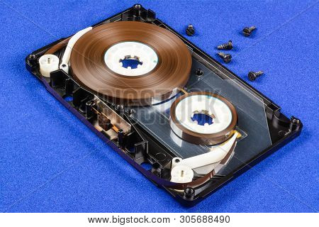 Disassembled Audio Compact Cassette With Sm Mechanism. Audio Cassette With Tape Guide As Security Me