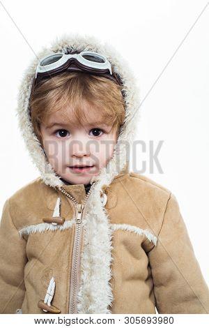 Kid Boy Dressed As Pilot. Child Boy Airplane Pilot. Happy Kid In Pilot Helmet, Jacket, Glasses. Drea