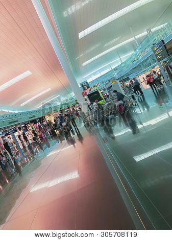 Barcelona, Spain - June 08, 2019. El Prat Josep Tarradellas Airport. Walking And Sitting Passengers,