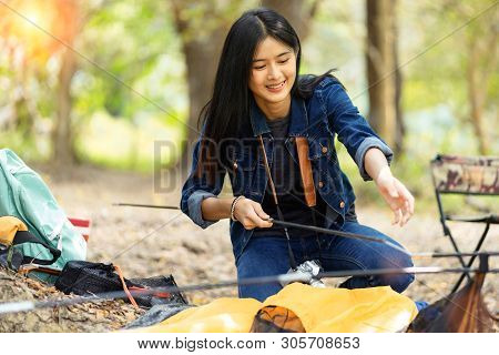 Friends Camping Concept.young Women  In Casual Wear And Enjoy  Camping At Forest.girls Are Helping T