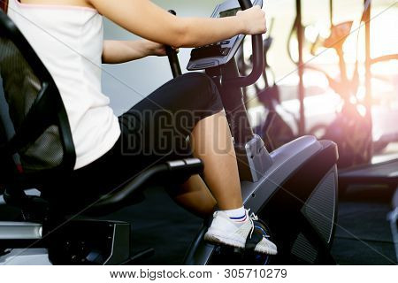 Women Exercising, Indoor Cycling In Fitness.sport Equipment