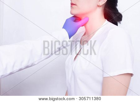 A Specialist Doctor Diagnoses And Examines A Girls Sore Throat, The Presence Of Inflammation And Swe